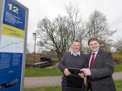 (l-r): Councillor Phil Bateman MBE (Wednesfield North) and Cabinet Member for City Economy, Cllr John Reynolds, alongside one of the new LNR signs