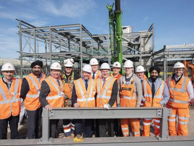 Wolverhampton Interchange partners and apprentices sign one of the steels to be used in the construction of the new railway station building