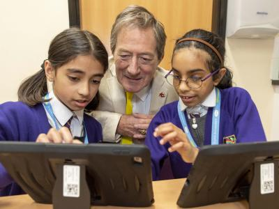 Councillor Dr Michael Hardacre, the City of Wolverhampton Council's Cabinet Member for Education and Skills joins pupils to find out how Lanesfield Primary School is using iPads to enhance learning