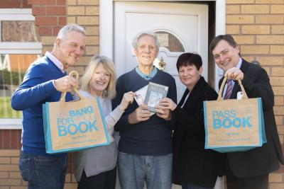 Celebrating the new partnership are Home Library Service volunteer delivery driver Nigel Ormerod, Citizens Advice W-ton Home Library Service Coordinator Bridget Pugh, customer Albert Clinton, Kath Aston from Bushbury Buddies, Cllr John Reynolds, the CWC Cabinet Member for City Economy