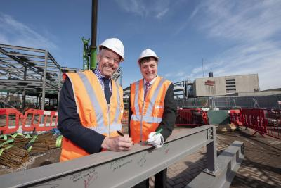 (l-r): Malcolm Holmes, TfWM Director of Rail (part of WMCA) and Cllr John Reynolds, City of Wolverhampton Council sign the steel