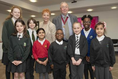 The Mayor and Mayoress of Wolverhampton, Councillor Phil Page and Elaine Hadley-Howell, with some of the winners of the schools' Fairtrade poster competition