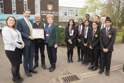 Celebrating School of Sanctuary Status are pupils from Colton Hills Community School with, left to right, Diana Dabrowska-Gorska, the City of Wolverhampton Council's English as an Additional Language Teacher Advisor, Headteacher Alberto Otero, Founder of the City of Sanctuary Dr Rev Inderjit Bhogal and Deputy Headteacher Jane Lockley