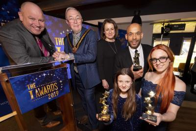 Celebrating success at the I Awards are young people Belle Kisby and Casey Gavin with Dicky Dodd, Mayor of Wolverhampton Councillor Phil Page, Matt Murray and the City of Wolverhampton Council's Director of Children's Services Emma Bennett