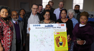 Members of Interfaith Wolverhampton proudly holding a physical representation of the Wolverhampton Faith Map
