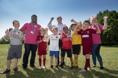 Celebrating summer at one of the hundreds of Summer Squad activities - this one was organised by The Way Youth Zone at Ashmore Park - are children with Councillor John Reynolds, Cabinet Member for Children and Young People, and Dave Harvey from The Way
