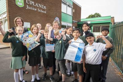 Pupils celebrating after winning the UNICEF Rights Respecting School Award with Councillor Dr Michael Hardacre, the City of Wolverhampton Council's Cabinet Member for Education and Skills, and Sarah Lane, Rights Reception Lead Teacher