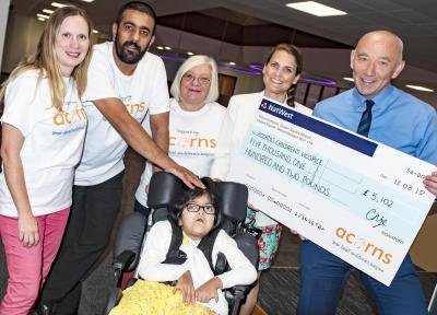 Tim Johnson, Managing Director at City of Wolverhampton Council pictured with Livvy from Acorns Children's Hospice, Amjid Mehmood with his daughter Zara and his transport colleagues Amanda Millard and Linda Downing