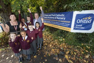 Headteacher Jenny Byrne, Cabinet Member for Education and Skills Councillor Dr Michael Hardacre and pupils celebrate SS Peter and Paul Catholic Primary Academy's Good rating