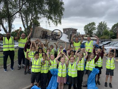 Pupils from Trinity Church of England Primary School with team members from the council's Environmental Services and Public Protection team. (Elliott, standing on the far right)