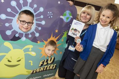 Berrybrook Primary School pupils Finley Johnson, Harlow McInnis and Courtland Skitt become Flu Fighters after receiving their nasal spray from Vaccination UK nurse Helen Burrell