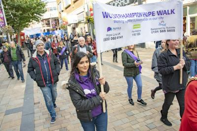 Dozens of people joined the Hopewalk around the centre of Wolverhampton yesterday