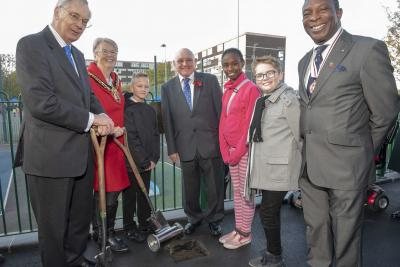 (L-R): HRH The Duke of Gloucester buries the time capsule with schools' competition winners Nicolas Janisz (St Stephen's Primary School), Christina Izogie (formerly of Woden Primary School) and Reece Brookes (Trinity CofE Primary School), alongside Mayor of Wolverhampton, Councillor Claire Darke, Heath Town photographer/historian, Vic Collins, and Deputy Lieutenant for the West Midlands, Mr Martin Levermore