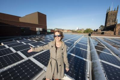 The council's Member Champion for Climate Change, Councillor Barbara McGarrity, with the solar panels on top of the Civic Centre