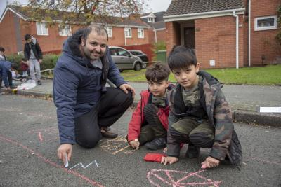 Children can play safely outside their homes