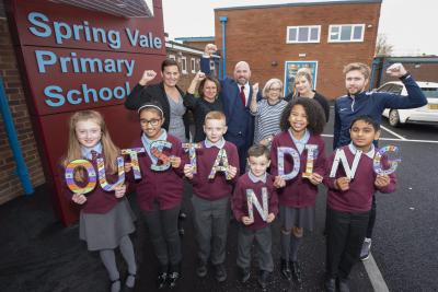 Pupils celebrate Spring Vale Primary School's Outstanding report with back, left to right, the City of Wolverhampton Council's Director of Children's Services Emma Bennett, the City of Wolverhampton Council's Head of School Improvement Amanda Newbold, Headteacher Chris Blunt, Leadership Team member Linda Vawer, Assistant Headteacher Katie Manning and Leadership Team member Tom Kelly