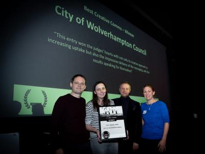The City of Wolverhampton Council's Communications Manager Paul Brown and Digital Communications Officer Stacey Hinton collect the UnAward for Best Creative Comms from Darren Caveney of comms2point0 and Caroline Roodhouse from Alive with Ideas