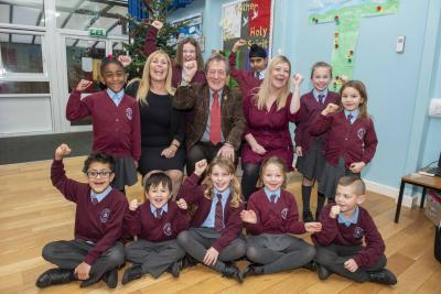 Councillor Dr Michael Hardacre, Cabinet Member for Education and Skills, celebrates with children and Executive Headteacher Katy Kent and Headteacher Rachael Kilmister from St Bartholomew's C of E Primary School which was included in the Sunday Times Parent Power guide as one of the country's best primary schools