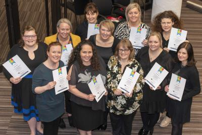 Special Educational Needs and Disabilities Outreach Service Co-ordinator Dr Eve Griffiths, centre, with teachers who have successfully completed the Autism Leaders Award
