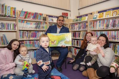 Councillor Harman Banger, the City of Wolverhampton Council's Cabinet Member for City Economy, is joined by Library and Information Assistant Adrienne Withers and April Turner and Kate Semilia and their children at the refurbished Finchfield Library