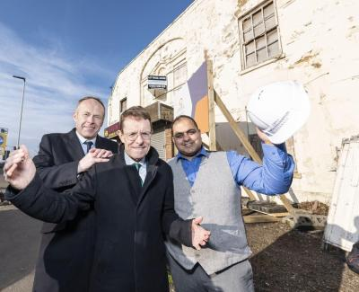 (l:r) Jon Bramwell, chair of the Regional Town Centre Taskforce and a managing director at HSBC Commercial Banking, Mayor of the West Midlands Andy Street and Councillor Harman Banger, cabinet member for city economy at City of Wolverhampton Council outside the derelict Pipe Hall