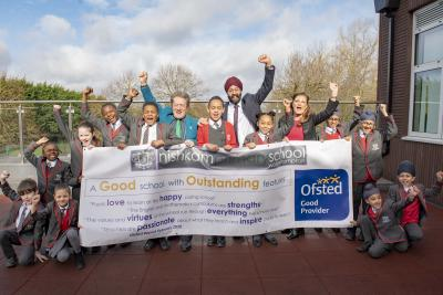 Celebrating Nishkam Primary School's Good Ofsted rating are pupils with Councillor Dr Michael Hardacre, Cabinet Member for Education and Skills, Headteacher Harmander Singh Dhanjal and Debbie Westwood, the Director of Primary Education for Nishkam School Trust