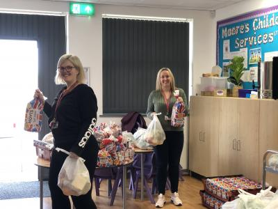 Loxdale Primary School teaching assistant Leanne Flitcroft and Assistant Headteacher Donna Mould  giving out food parcels