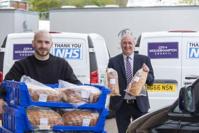 (LtoR) Baker James Price with Councillor Steve Evans delivering fresh bread to the city's emergency food distribution hub