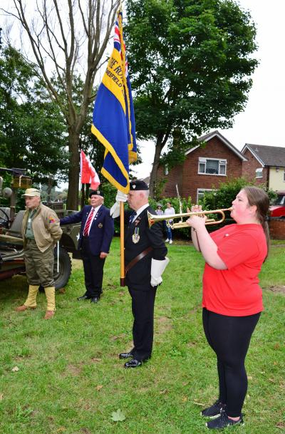 The standard bearer and bugler marking a minute's silence