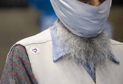 Surinder Singh proudly displays his 'I've had my Covid vaccination' sticker