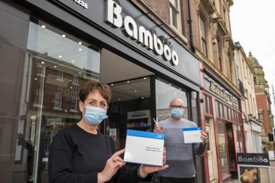 Staff at Bamboo Hair are among those having a regular rapid Covid-19 test. Pictured are Director Adriana Francis and Manager Stephen Hollings with home test kits