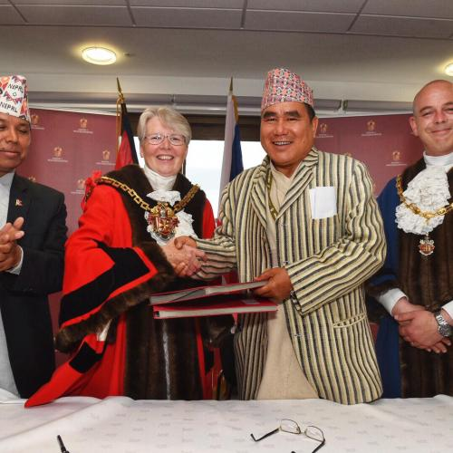 (l-r) Nepalese Ambassador, Dr Durga Bahadur Subedi, Mayor of the City of Wolverhampton, Cllr Claire Darke, Mayor of Arjundhara Municipality, Hari Kumar Rana and Deputy Mayor of the City of Wolverhampton, Cllr Greg Brackenridge sign a memorandum of understanding between the two cities