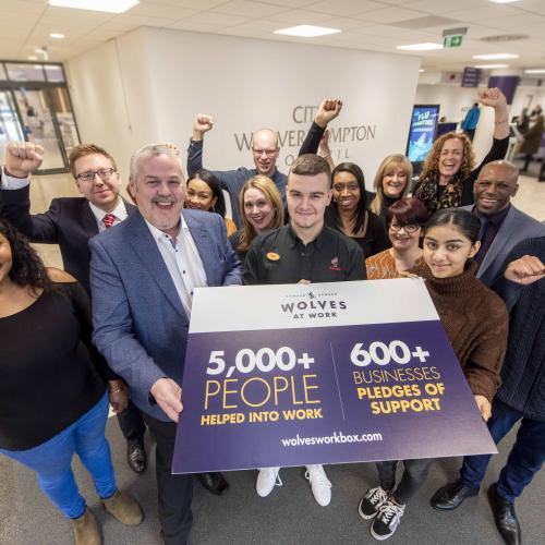 City of Wolverhampton Council Leader, Councillor Ian Brookfield, and DWP Jobcentre Operations Leader, Dez Grant, with employees and employers supported by the Wolves at Work programme