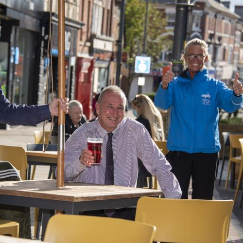 Cabinet Member for City Environment, Cllr Steve Evans, enjoys a drink on the new seating outside The George Wallis with General Manager designate Stonegate Pubs, Adam Davis, and Wolverhampton BID Ambassador, Jo Parker